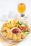 Fast food lunch with chicken nuggets, french fries and vegetable Royalty Free Stock Image
