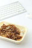 Fast food lunch on working desk Royalty Free Stock Image