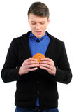 Fast food. Man eating a hamburger isolated on a white background Stock Photography