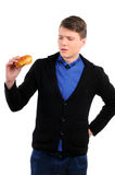 Fast food. Man eating a hamburger isolated on a white background Royalty Free Stock Photo