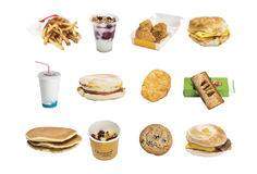 Fast Food - McDonald's $1 menu. Fast food - french fries, soda, chocolate chip cookie, apple pie, chicken nuggets, soda, pancakes, parfait, oatmeal, bacon, egg Stock Image
