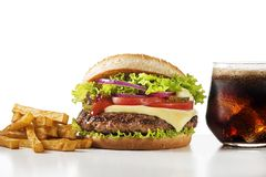 Fast food meal with hamburger, potato fries and cola drink royalty free stock images