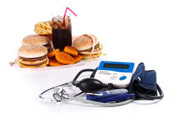 Fast-food and medical tools Royalty Free Stock Photo