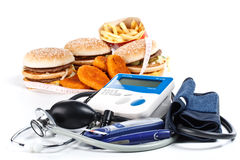 Fast-food and medical tools Stock Photo