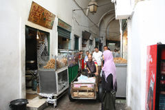 Fast food in the medina. Tunis,Tunisia - September 14th, 2012 :  People walking around fast food store in the Medina, famous marketplace in Tunis, Tunisia Royalty Free Stock Photography