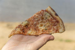 Fast food, pizza, on the beach Royalty Free Stock Photography