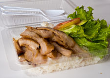 Fast food in a plastic box. Roasted pork and rice in a plastic box Stock Images