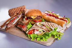 Fast food plate with burger hot dog sandwiches chicken wrap. Fast food plate with burger hot dog sandwiches and chicken wrap Stock Photo