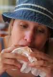 Fast food restaurant. Nice girl is eating in fast food restaurant Stock Photography