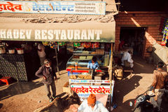 Fast food restaurant on dirt indian street Stock Image
