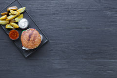 Fast food restaurant dish. Hamburger and potato wedges Royalty Free Stock Image