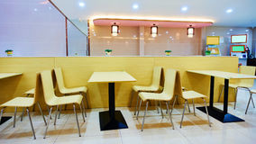 Fast food restaurant. Inside fast food restaurant with dining table and chair Stock Photo