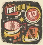 Fast food restaurant menu creative design concept. Burger, pizza, hot dog unique labels on black chalkboard. Retro ad template on old paper texture. Vintage Stock Images
