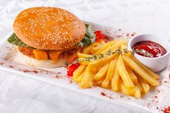 Fast food restaurant menu. Home made hamburger with the beef patties, onion, tomato, lettuce and cheese. Fresh burger royalty free stock photography