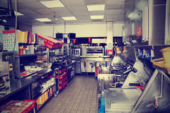 Fast food restaurant, toned image Royalty Free Stock Image