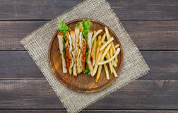 Fast food at sandwich bar, fries and toasts top view Royalty Free Stock Image