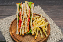 Fast food at sandwich bar, fries and toasts top view Stock Images