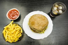 Fast food set - beef burger, french fries with ketchup and cola Royalty Free Stock Photo