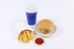 Fast food set containing burgers, french fries and soft drink isolated on white background Royalty Free Stock Photography