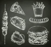 Fast food, sketches on the chalkboard. Vector set royalty free illustration