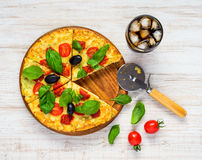Fast Food Sliced Vegetable Pizza with Cold Cola. Top View of Sliced Vegetable Pizza with Basil, Tomato and Glass of Cold Cola Royalty Free Stock Photos