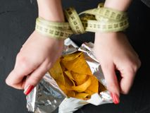 Fast food snacks bad diet habit woman eating chips stock photos