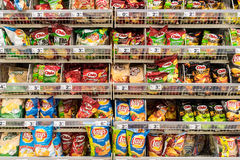 Fast Food Snacks On Supermarket Shelf Stock Image