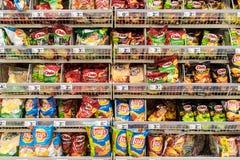 Fast Food Snacks On Supermarket Shelf Stock Image