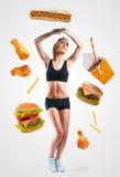 Fast food spada na młodej kobiecie Obrazy Royalty Free
