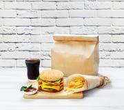 Fast food take away. Hamburger, cola and fries. Royalty Free Stock Photography