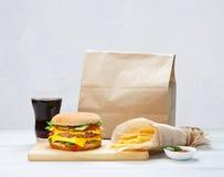 Fast food take away. Hamburger, cola and fries. Royalty Free Stock Photo