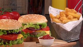 Fast food, Two Beef burger and french fries stock footage