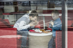 Fast food. Two brothers eating in a fast food restaurant Royalty Free Stock Images