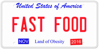 Fast Food USA. An imitation United States of America license plate with the words FAST FOOD and Land of Obesity on the bottom making a great concept Royalty Free Stock Image