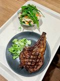 Fast Food Veal Chop with Salad served with Tray at Restaurant. stock images
