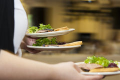 Fast food waitress serving food Royalty Free Stock Photos