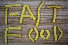 Fast food, written with french fries, written, word, words, writ. Ten, junk food royalty free stock image
