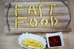 Fast food, written with french fries, written, word, words, writ. Ten, junk food stock photography