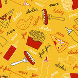 Fast food on a yellow background Stock Photography