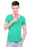 Fast Food. Young man eating fast food isolated on white background Royalty Free Stock Photography