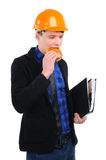Fast food. Young man in a helmet eating burger isolated on a white background Stock Images