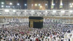 A fast forwarded footage of Muslim pilgrims circumambulate the Kaaba. A fast forwarded footage of Muslim pilgrims circumambulate the Kaaba at Masjidil Haram in stock footage