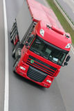Fast freight. Red truck driving high speed on the highway Royalty Free Stock Images
