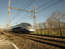Fast french tgv train. Very fasttgv train on blur motion in bright day Stock Photo