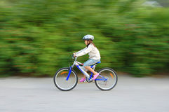 Fast girl on bicycle Stock Photography
