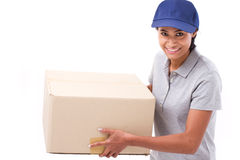 Fast, happy, female delivery service staff with parcel or carton. Box, white isolated background Stock Image