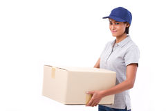 Fast, happy, female delivery service staff with parcel or carton. Box, white isolated background Royalty Free Stock Photo
