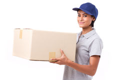 Fast, happy, female delivery service staff with parcel or carton. Box, white isolated background Stock Images
