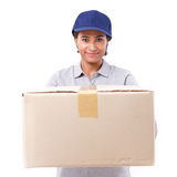 Fast, happy, female delivery service staff with parcel or carton. Box, white isolated background Royalty Free Stock Photos