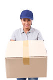 Fast, happy, female delivery service staff with parcel or carton. Box, white isolated background Stock Photos